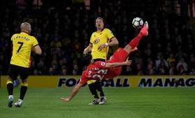 Emre Can stunner keeps Liverpool third